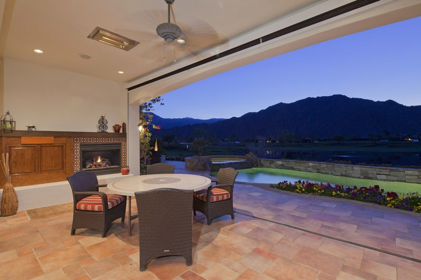 Luxury Covered Patio Area With Outdoor Dining And An Impressive View Of The  Surrounding Mountains.