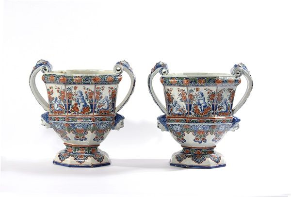 Pair of octagonal garden urns created from rare Delft porcelain
