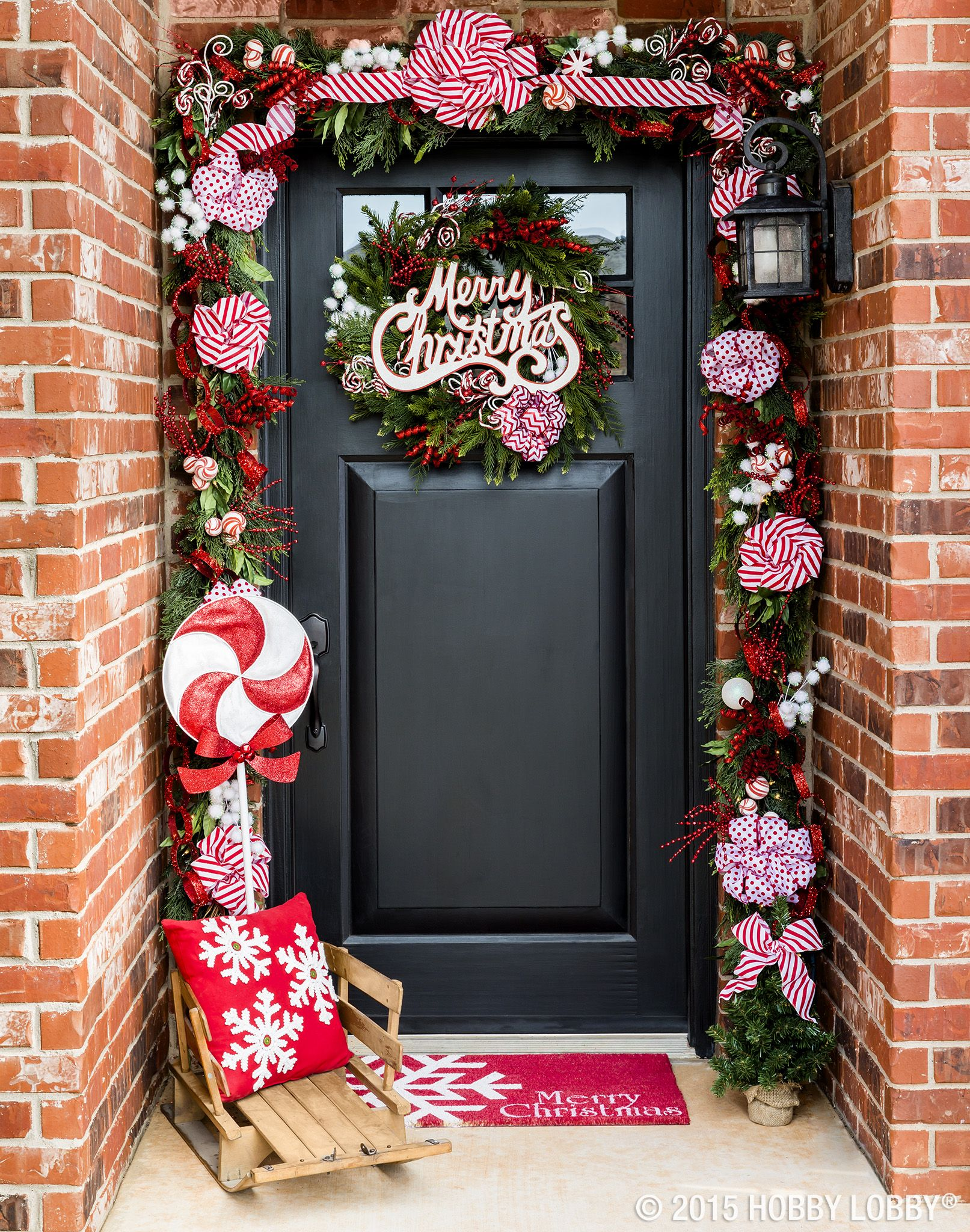Deck your front door with classic candy cane accents and ...
