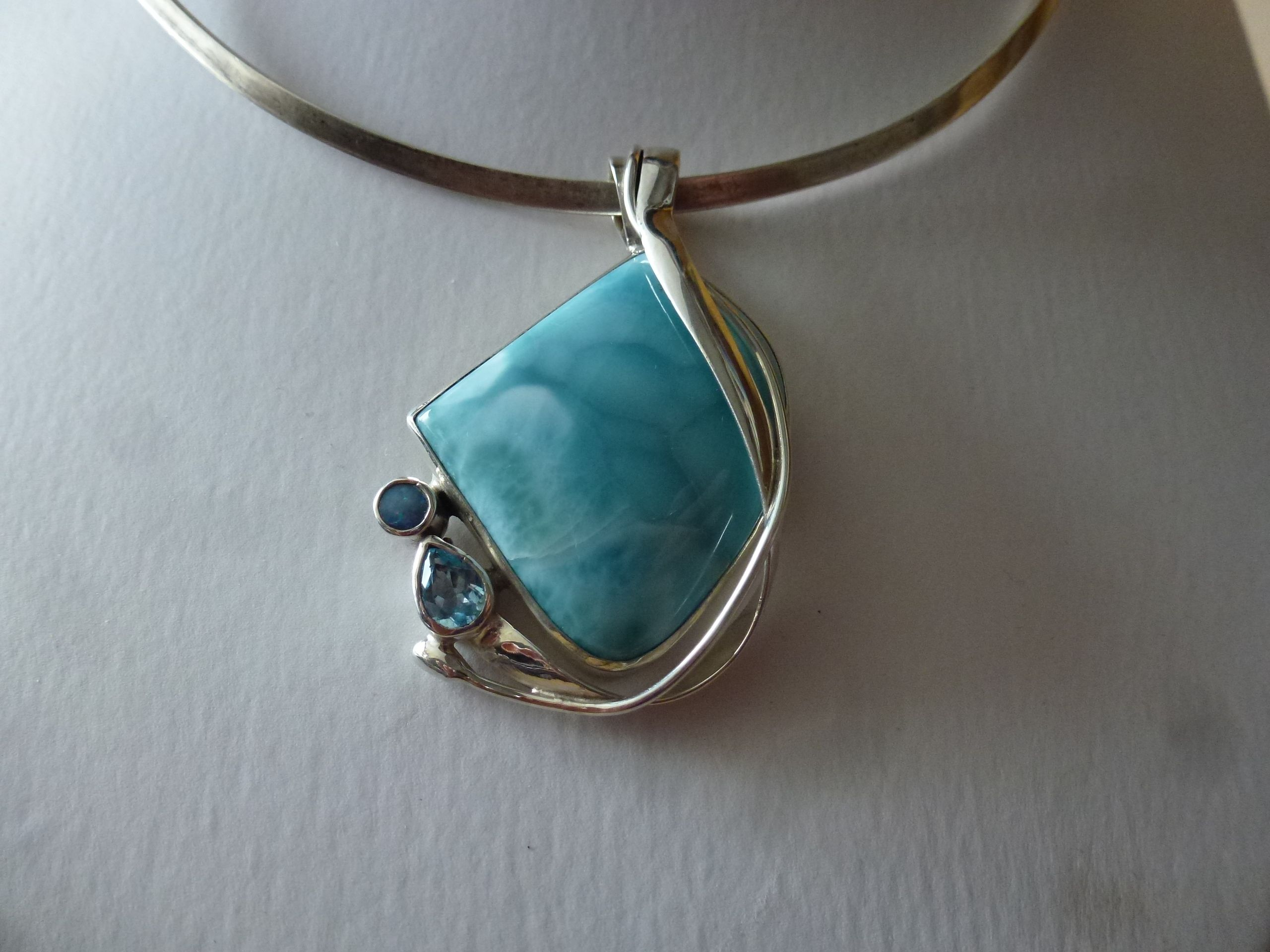 Pendant with 3 different stones set in silver in an assymetric design