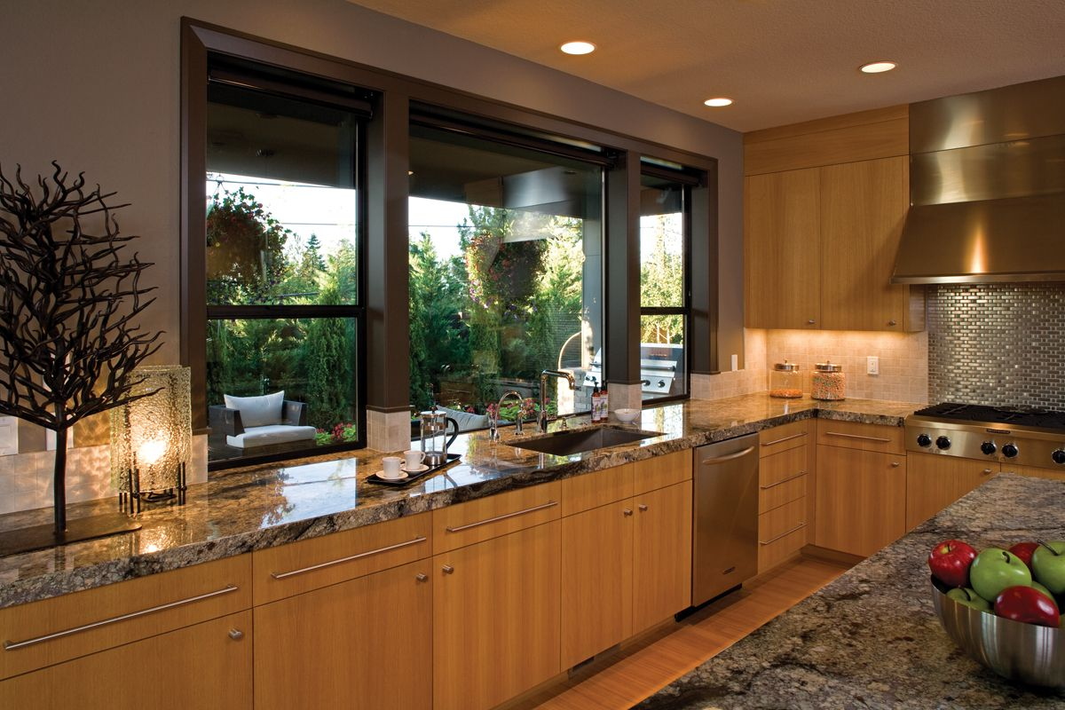 a sleek contemporary kitchen with granite tops and large slim