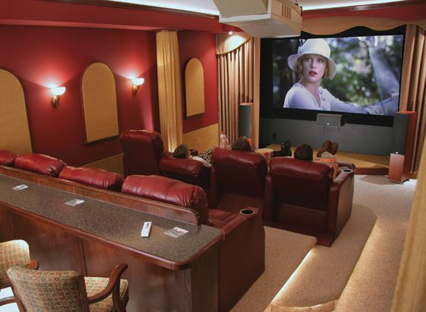 Narrow basement home theater we haven 39 t considered stadium for Long narrow basement design solution