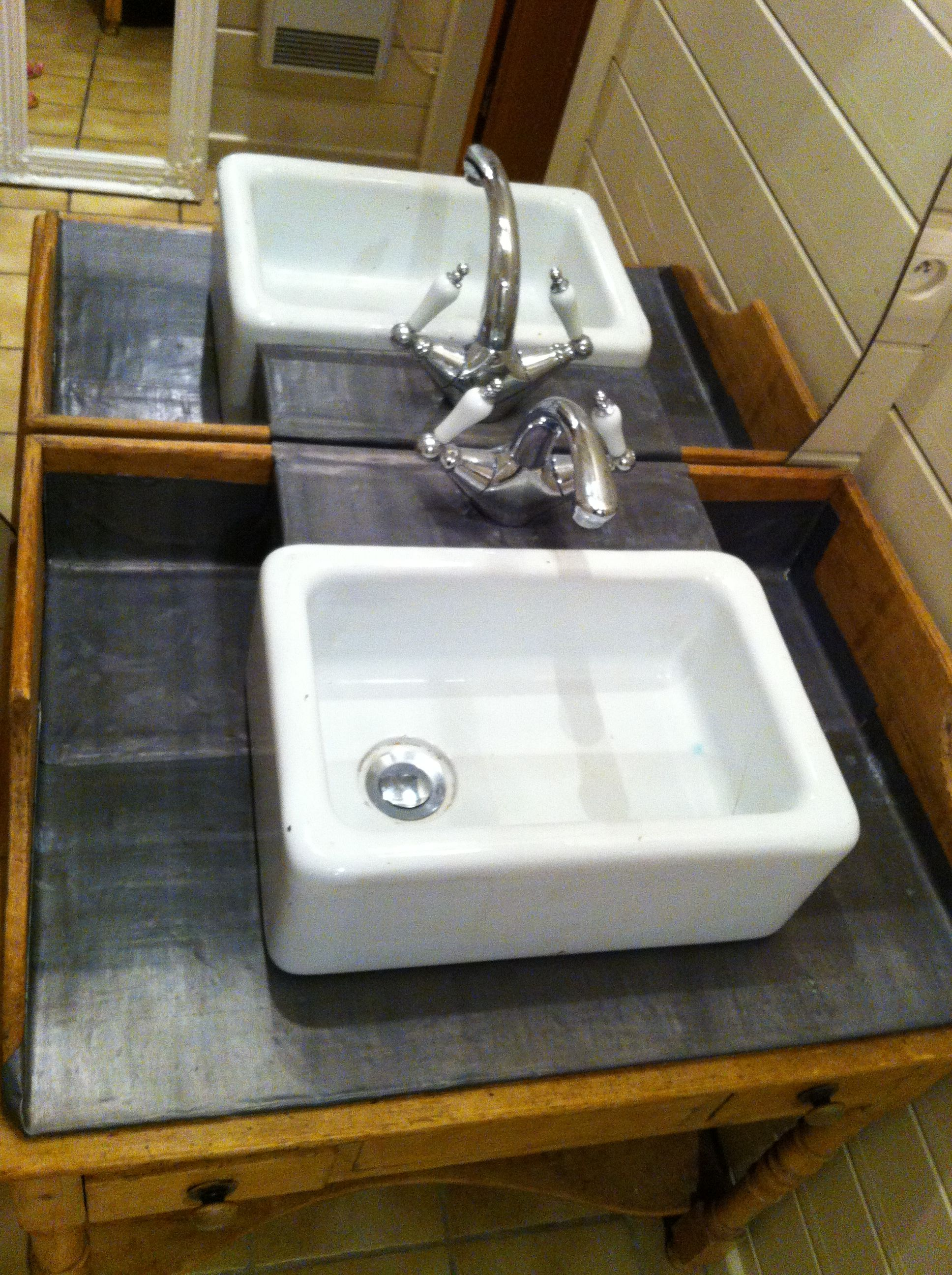 old sink, vintage wash stand and old mirror made in to a new bathroom sink.