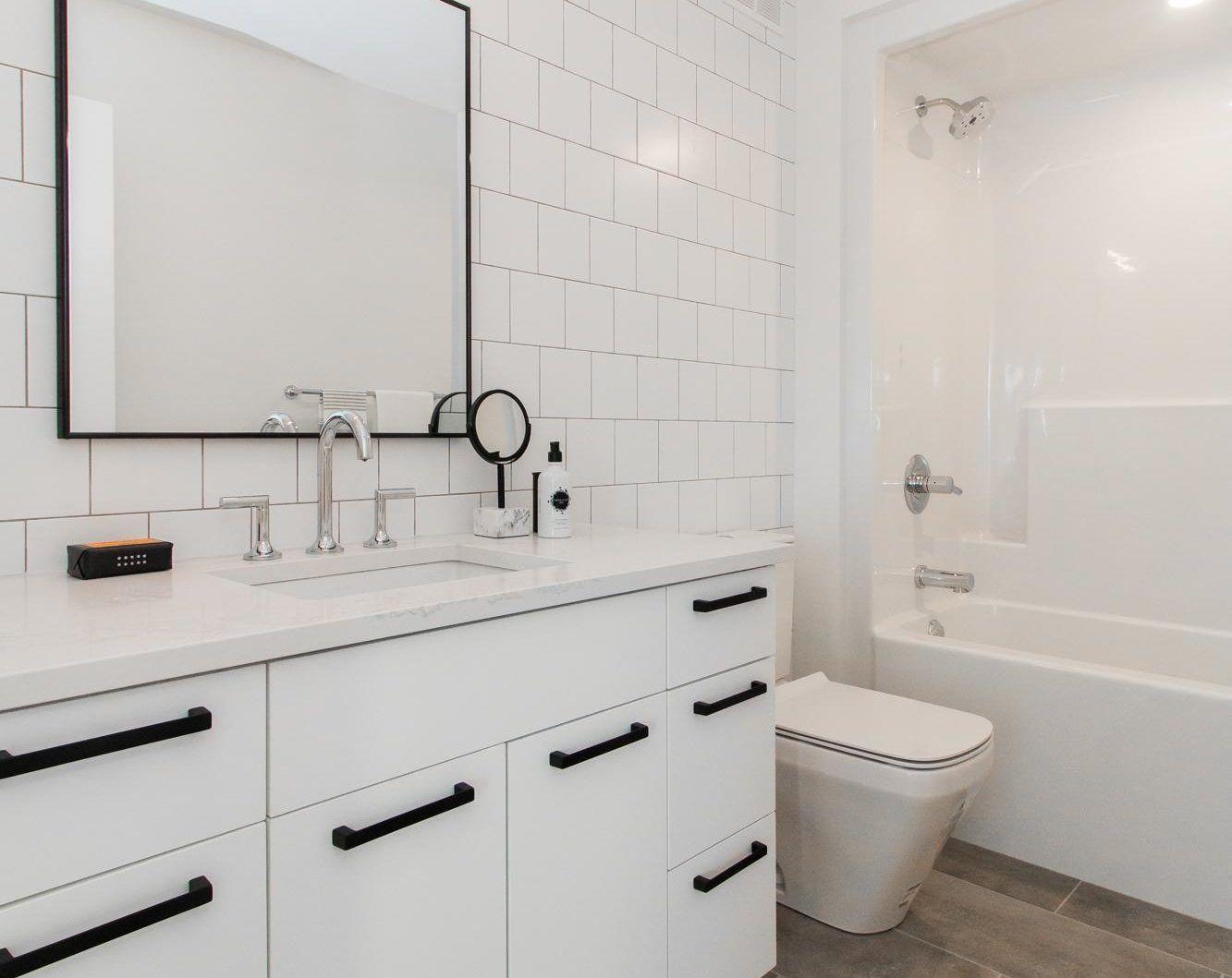 Northern Lights Interior Design Portfolio Winnipeg Modern White Bathroom Modern White Bathroom Lighting Design Interior Emtek Cabinet Hardware
