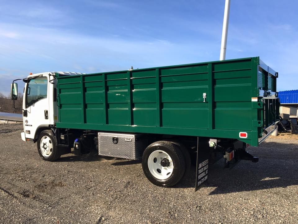 This Isuzu Was Completed With A The Knapheide Manufacturing Company Landscape Body And Rugby Manufacturing Hoist Looks Great In Green Work Truck Body Hoist