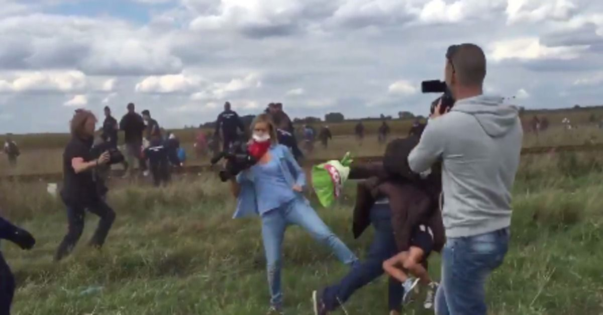 A Hungarian camerawoman was fired on Tuesday after shocking footage emerged of her intentionally tripping refugees fleeing police near the country's border.