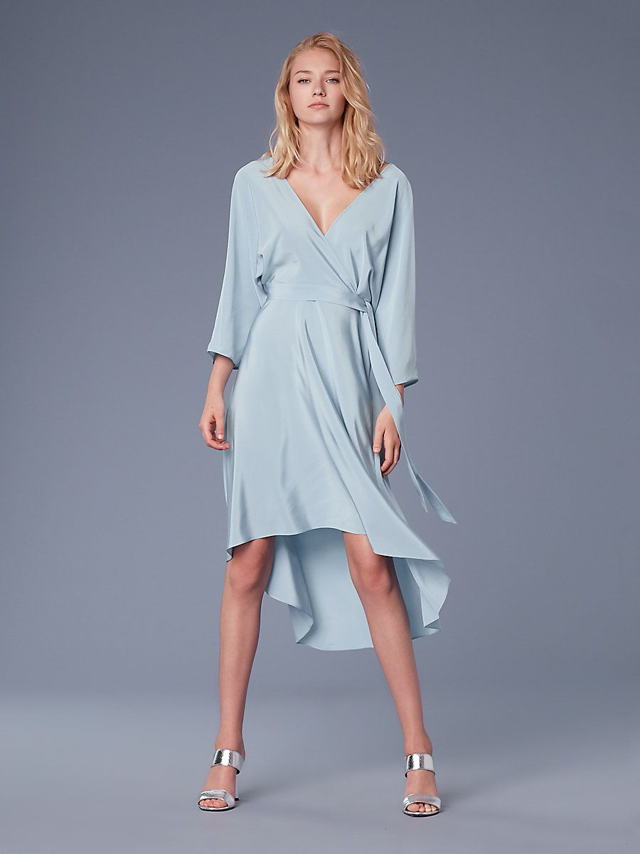 23a9c4ce40b9 Cut in 100% woven silk, this asymmetric mini wrap dress is feminine and  sophisticated. It features a kimono-inspired top with a self-tie belt and  wide ...