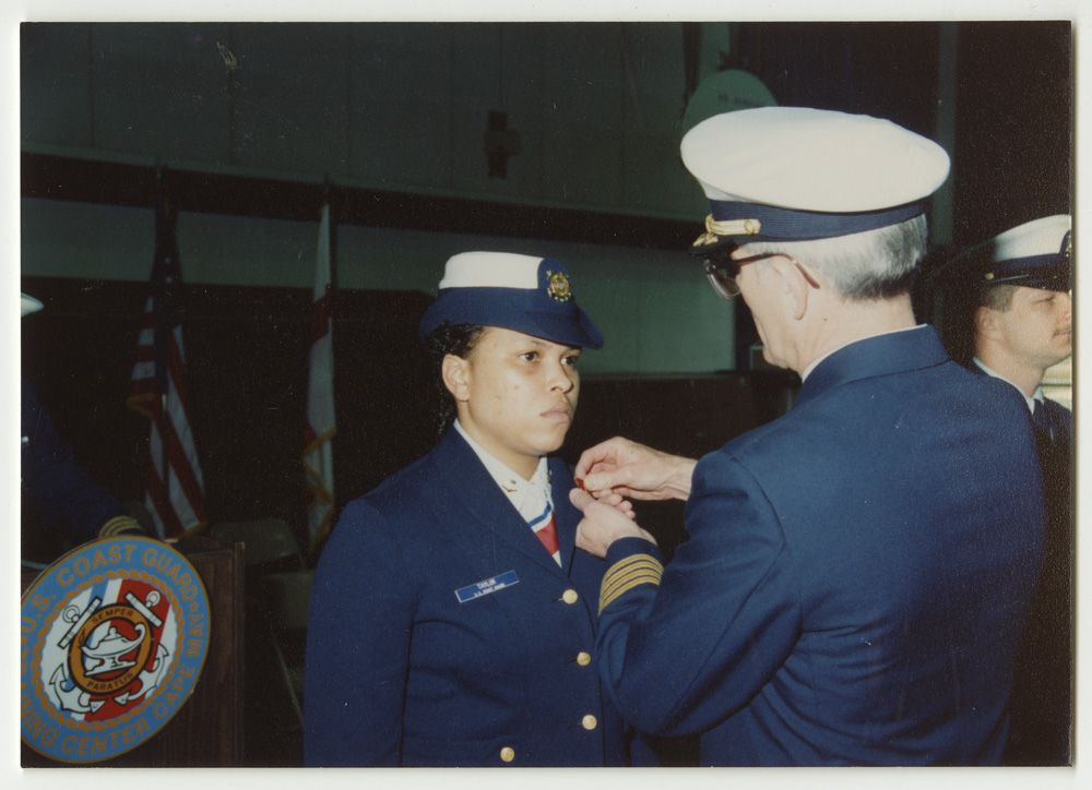 Flora V. Taylor receiving a pin - The Betty H. Carter Women Veterans Historical Project - UNCG University Archives