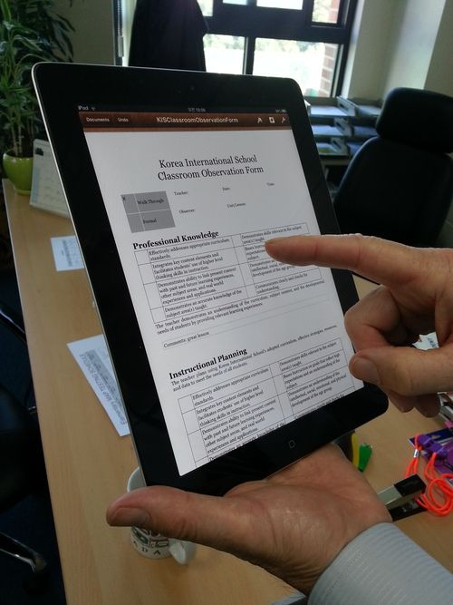 Administrators Use iPad to Fill Out Teacher Observation Forms