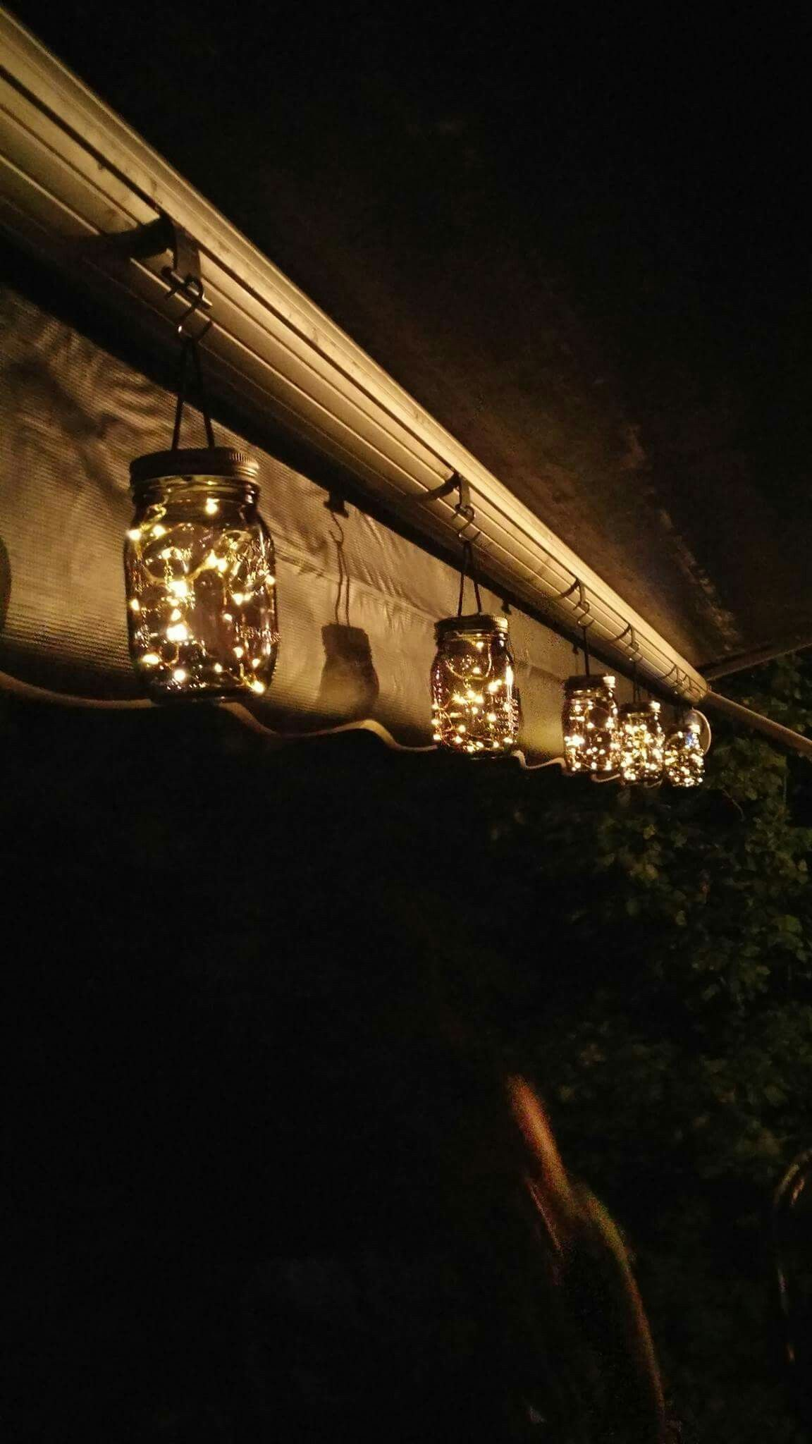 Mason jars filled with solar lights for the awning ...