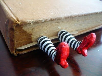 Wicked witch of the West legs bookmark made out of polymer clay.