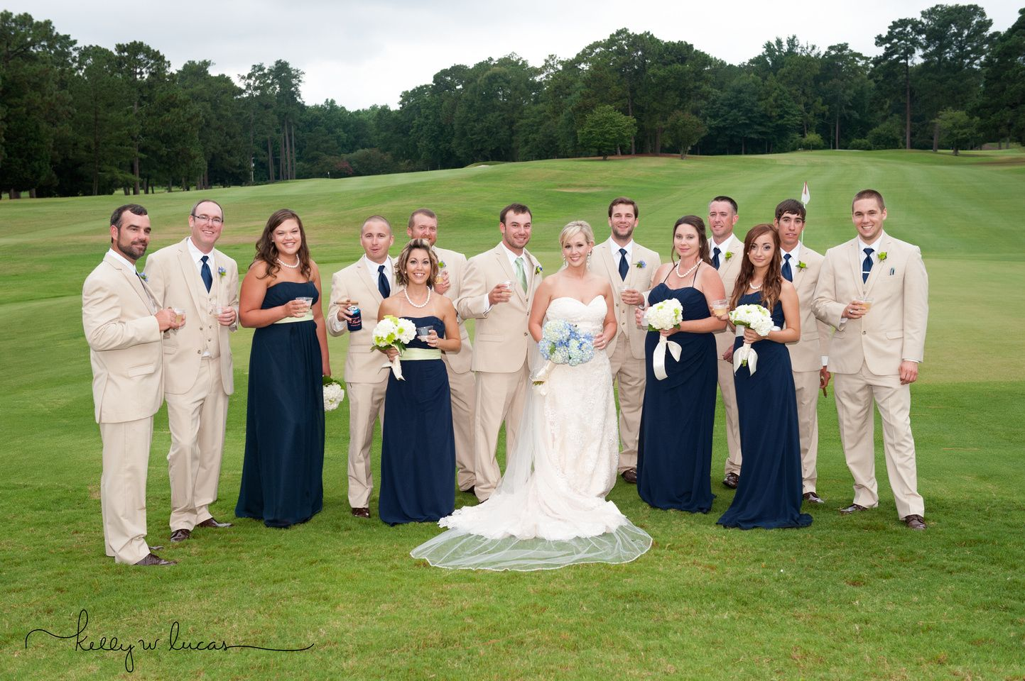 Wedding party on the th green at camden country club in camden sc