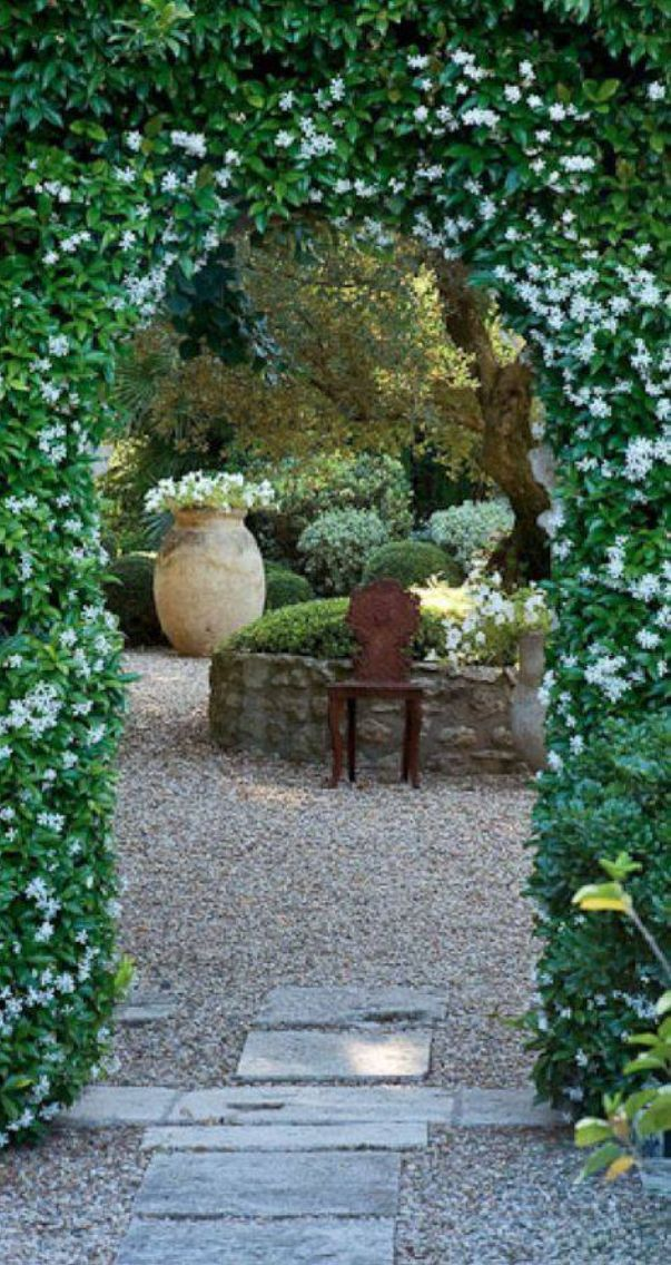 So Incredibly Beautiful Love The Rose Covered Archway Leading The Way Into The Glorious Garden With A Chair Beautiful Gardens Secret Garden Gorgeous Gardens