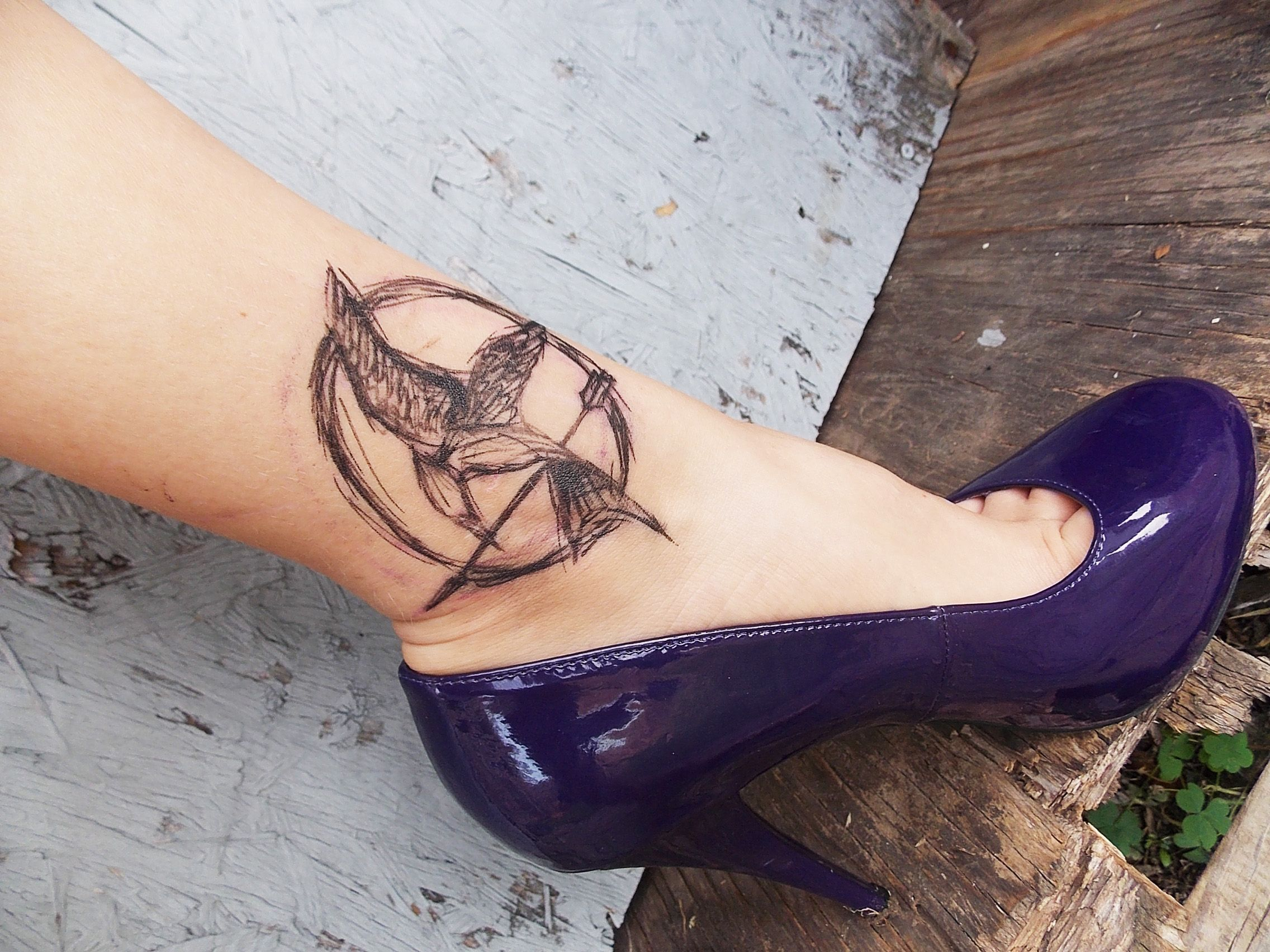 tatouage oiseaux femme hunger games