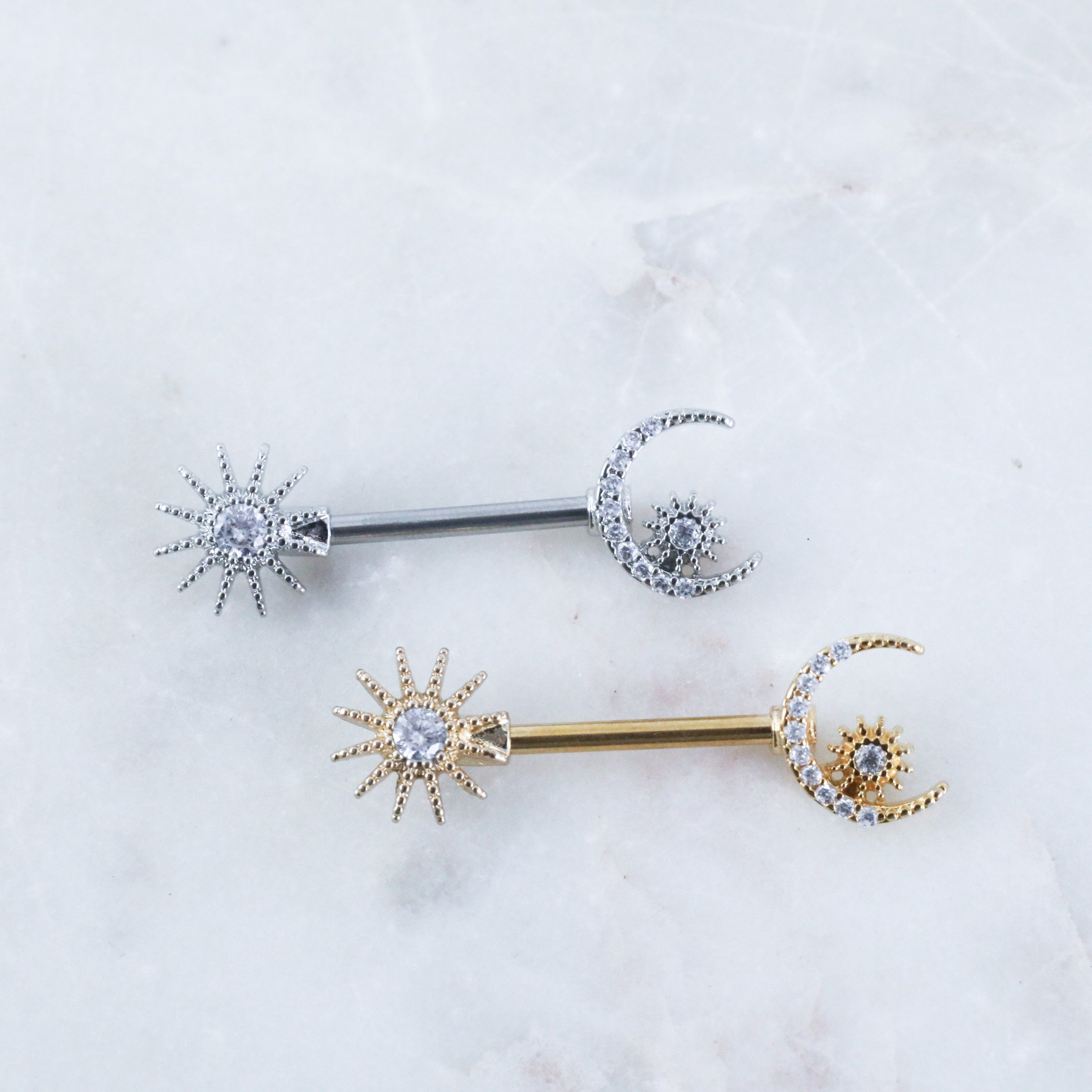 The Star & Moon Nipple Barbell is such a cute jewelry option for your nipple piercings! It is sold by SINGLE piece and is 316L surgical steel made with pvd plating (gold) at 14 gauge (1.6mm) and 9/16