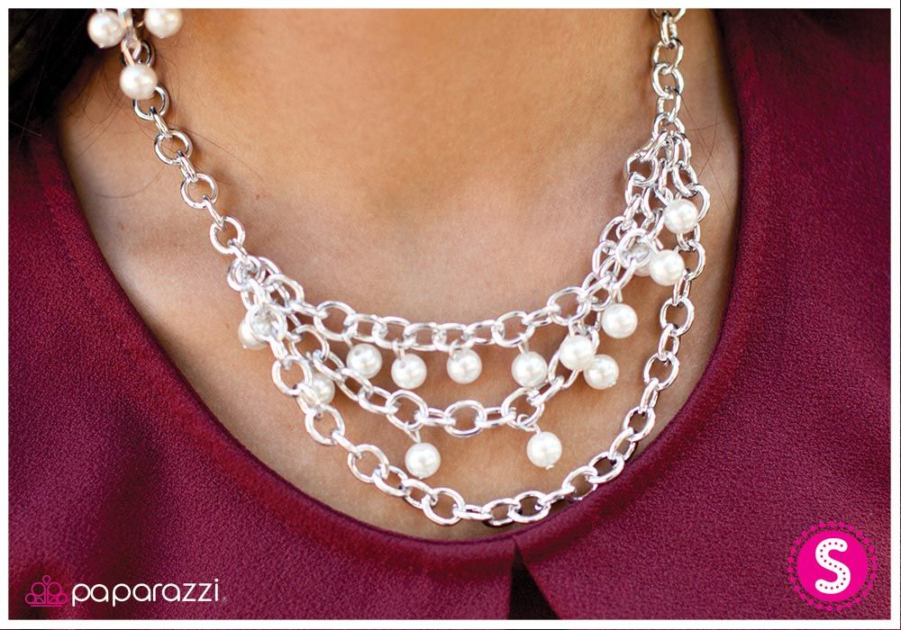 Draped in Radiance - White: Two layers of silver chain are adorned with white shimmering beads with a pearlized finish. A third silver chain adds grace and texture to this vintage-inspired look. Features an adjustable clasp closure. Buy now from www.paparazziaccessories.com for only $5!