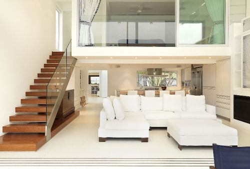 12 Loft Mezzanines: The glassed-in mezzanine above the living room is  intriguing.