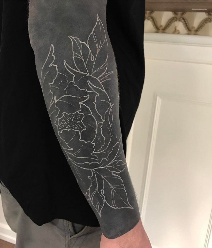 Negative Space Blackwork Tattoo Of A Flower Inked On The Right Forearm Black Sleeve Tattoo Cover Tattoo White Tattoo