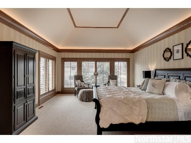 Beautiful and sophisticated master bedroom design with tray vaulted ceiling. Simple and elegant!