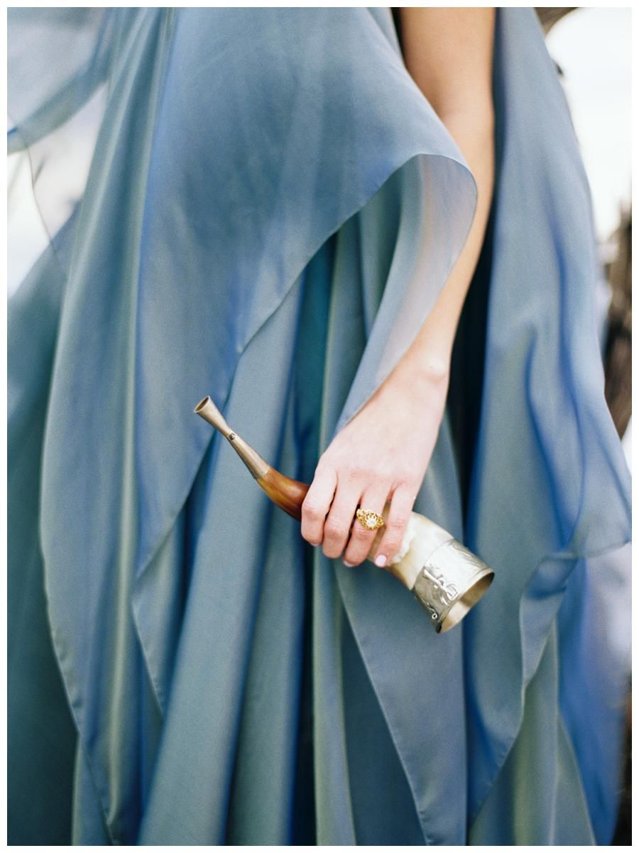 Blue wedding dress by Carol Hannah, engagement ring Trumpet & Horn. Image by Perry Vaile Photography.