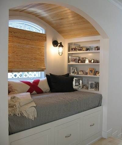 Guest room bed/reading alcove with built-in lighting & shelves. Very clever storage drawers/bins under the bed. Lots of function in a small space.