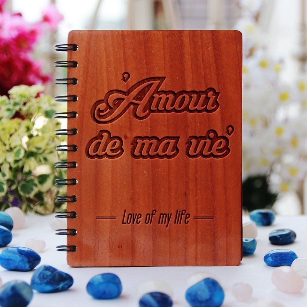 Description Amour de ma vie: Love of my life Say it in French. It does not get more romantic than that. If romance had a language, it would be French. French is considered one of the most romantic languages. Impress your girlfriend or boyfriend with this love journal made of wooden. This personalized wooden notebook is the best romantic gift for the love of your life. Email us at us.hello@woodgeekstore.com . Specifications - Pure wooden hardcover notebook. - The regular notebook measures 18 x 13