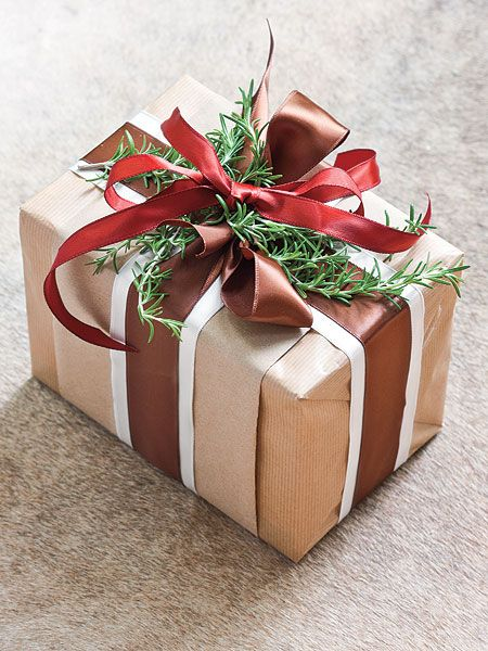 gift wrapping ideas | Christmas gift wrapped with brown paper, red and crimson ribbon, and ...