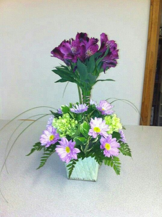 Purple alstroemeria coming out of an arrangement of ...