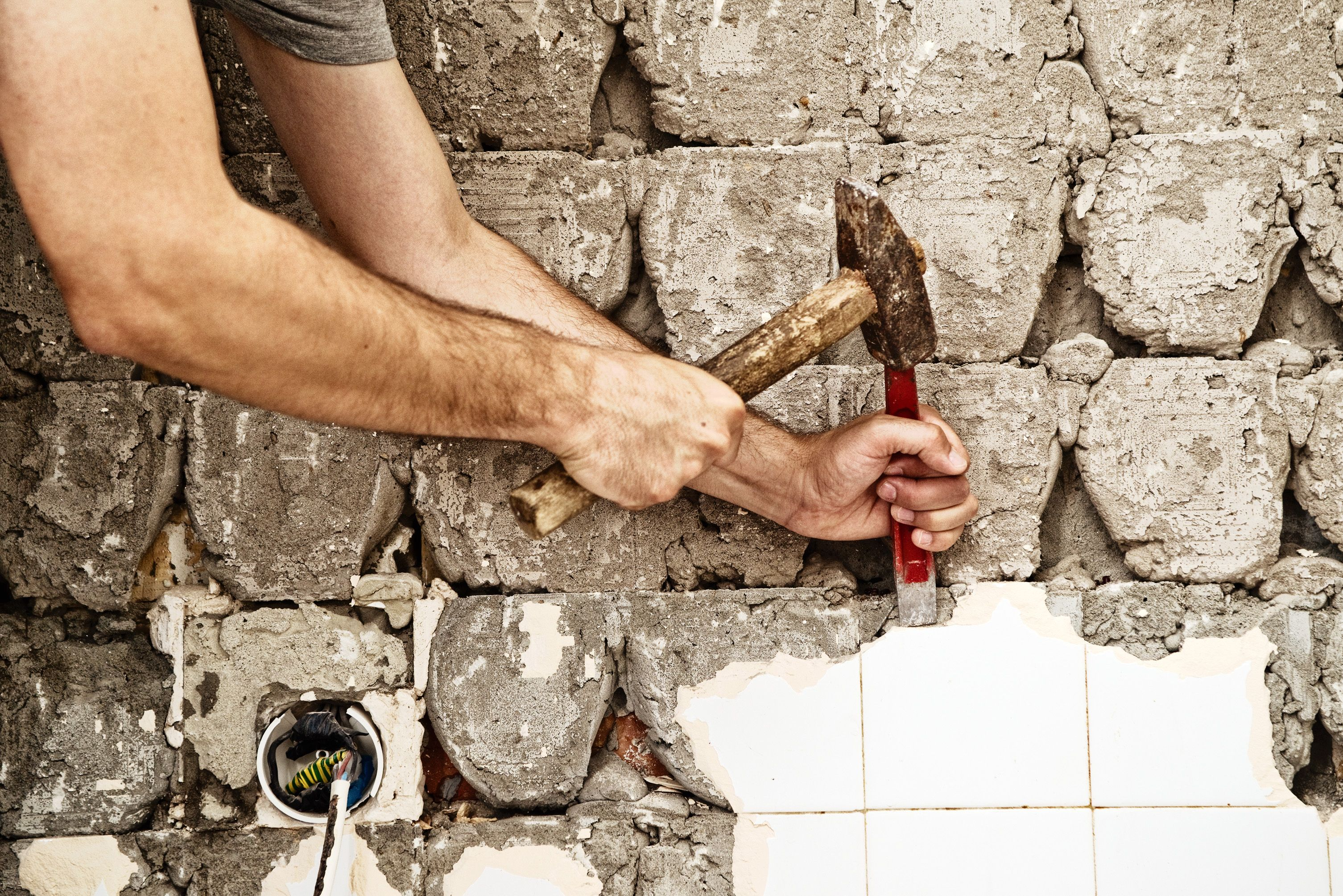 How to remove tile backsplash without damaging drywall