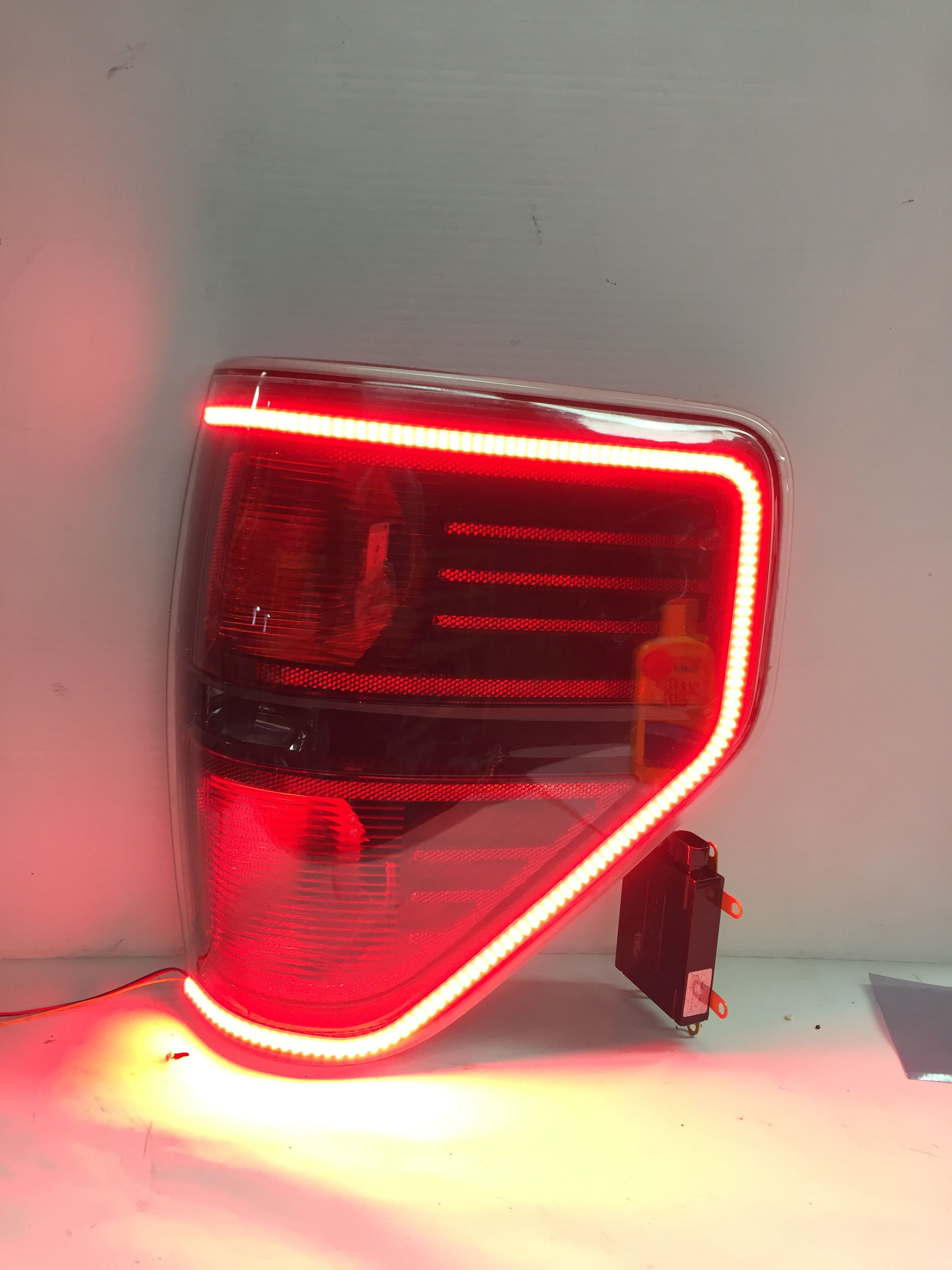 hight resolution of our custom oem ford f150 and raptor tail lights are here these modified oem tail lights feature the 2015 style wrap around led running light that functions