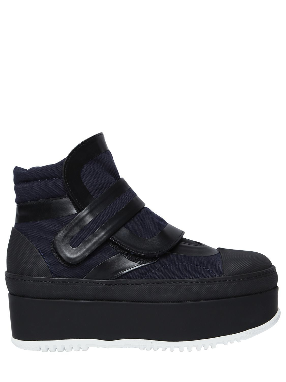 20cebf13e4f MARNI 50MM CANVAS   LEATHER PLATFORM BOOTS.  marni  shoes