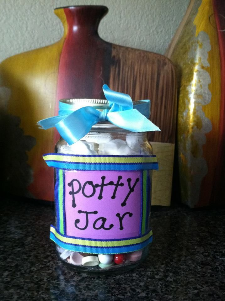 Mason jar filled with marshmallows and candy. The toddler gets a treat when she goes potty!