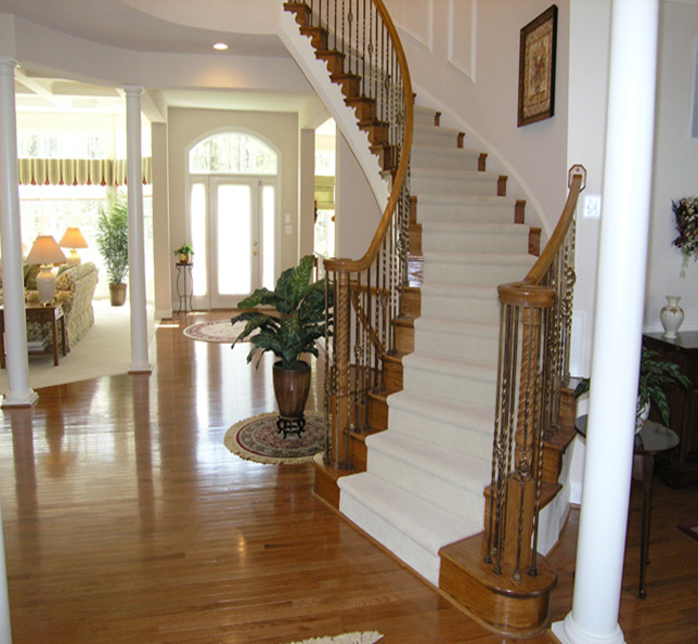 Curved Front Entry Way Stairs In Home | Spiral Staircase Graces The Grand,  Light