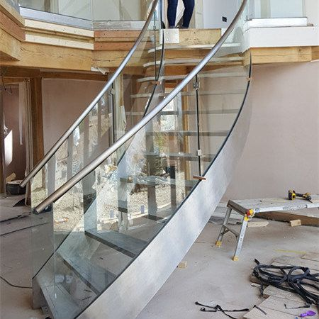 Curved Staircase | Stainless Steel and Glass Railing Curved