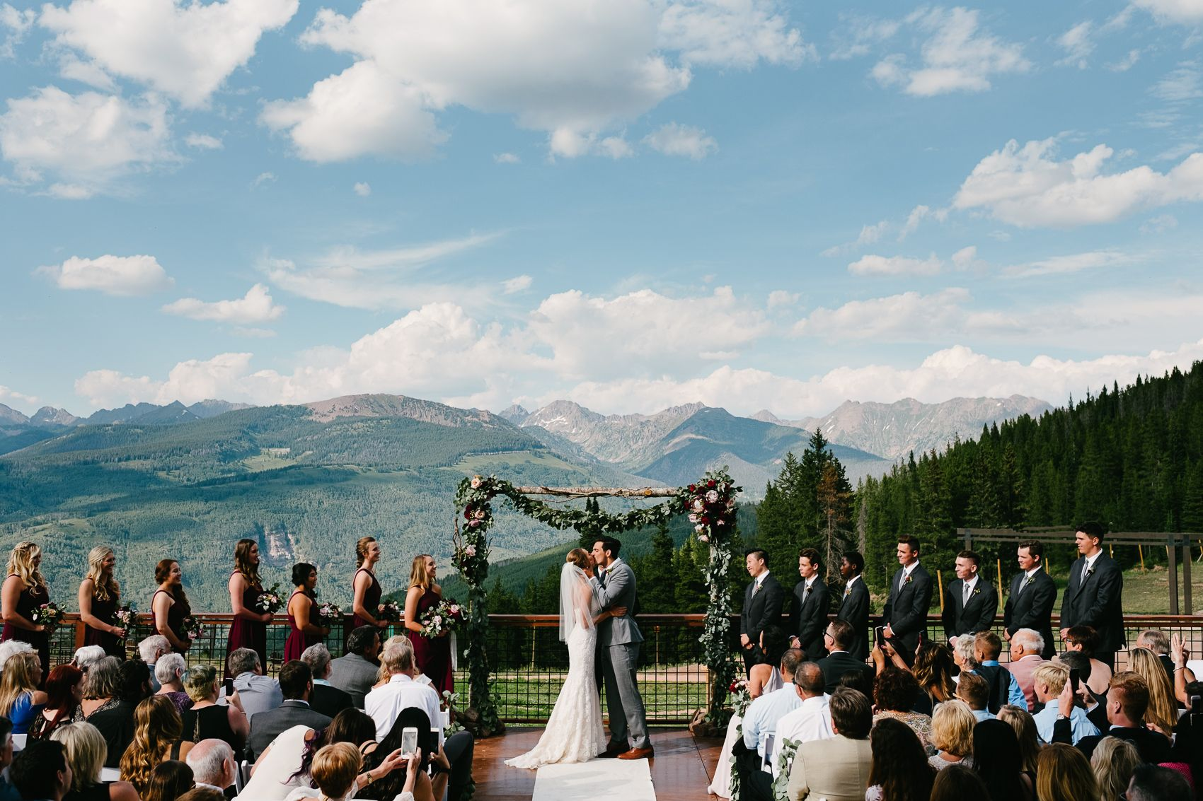 Now That S A First Kiss Backdrop At The 10th At Vail Wedding Wedding Vail Ski Resort Wedding Colorado Wedding Photography