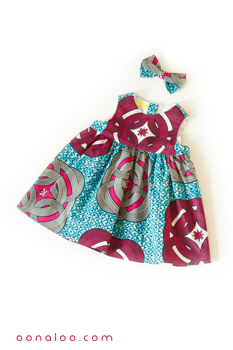 456e7716 This adorable baby girl dress and bow outfit in a blue and deep red Ankara  print would make a lovely and unique baby shower gift.