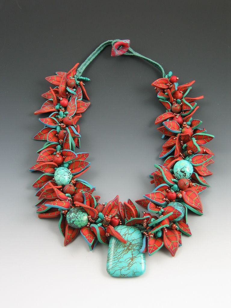 Necklace | Janet Farris.  Necklace of copper colored polymer clay leaves. Turquoise centerpiece and beads