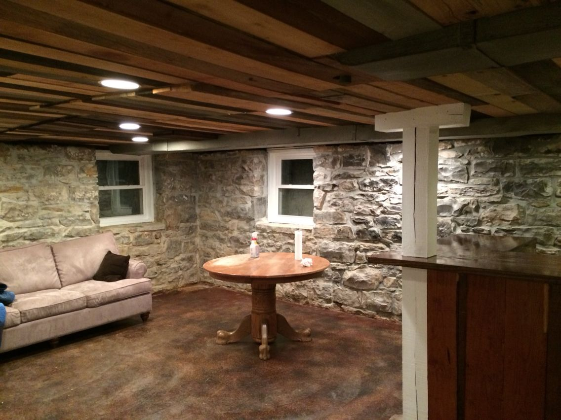 Basement stack stone stained concrete ceiling made from mix of reclaimed and repurposed wood - Basement concrete wall ideas ...