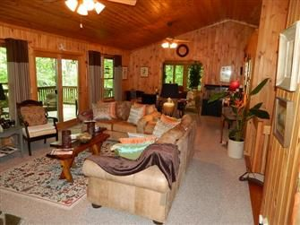 Great room with freestanding wood burning stove, accented wood walls and ceiling.  Conveniently located close to hiking trails, shopping, golf and only minutes from Blowing Rock.