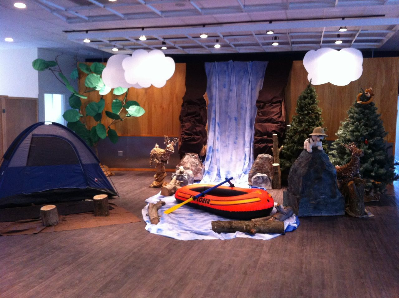Sonrise national park a tent on stage with waterfall and for Amusement park decoration ideas