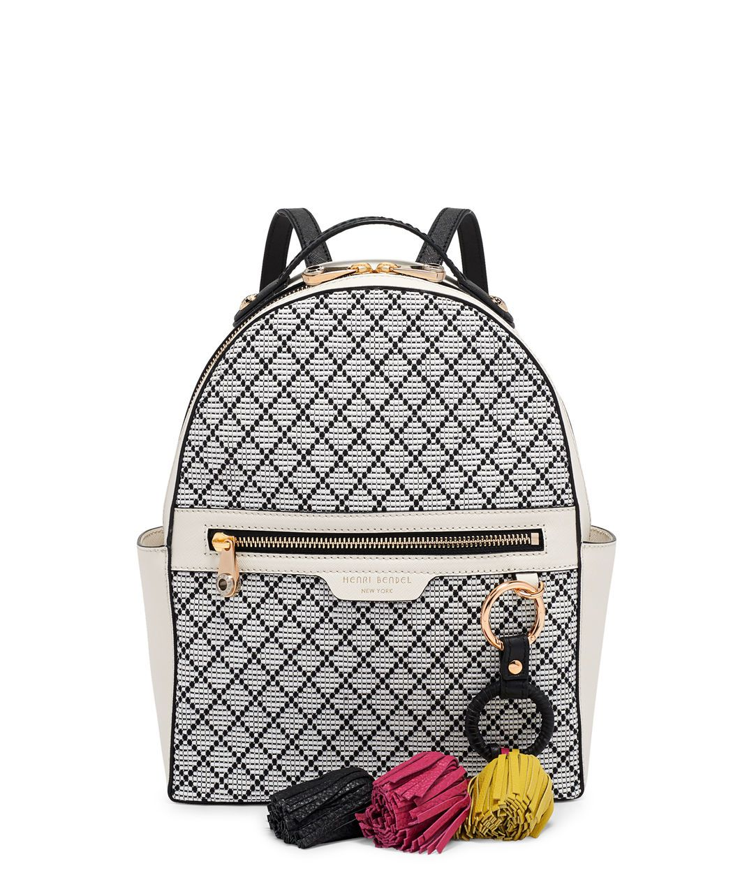Intricate yet effortless, the West 57th Straw Tassel Backpack is the luxury handbag choice for a global Bendel Girl. Crafted with saffiano leather and exquisite lattice straw detailing, this efficiently appointed handbag offers tons of secure pocket space perfect for any awaiting spring adventure.