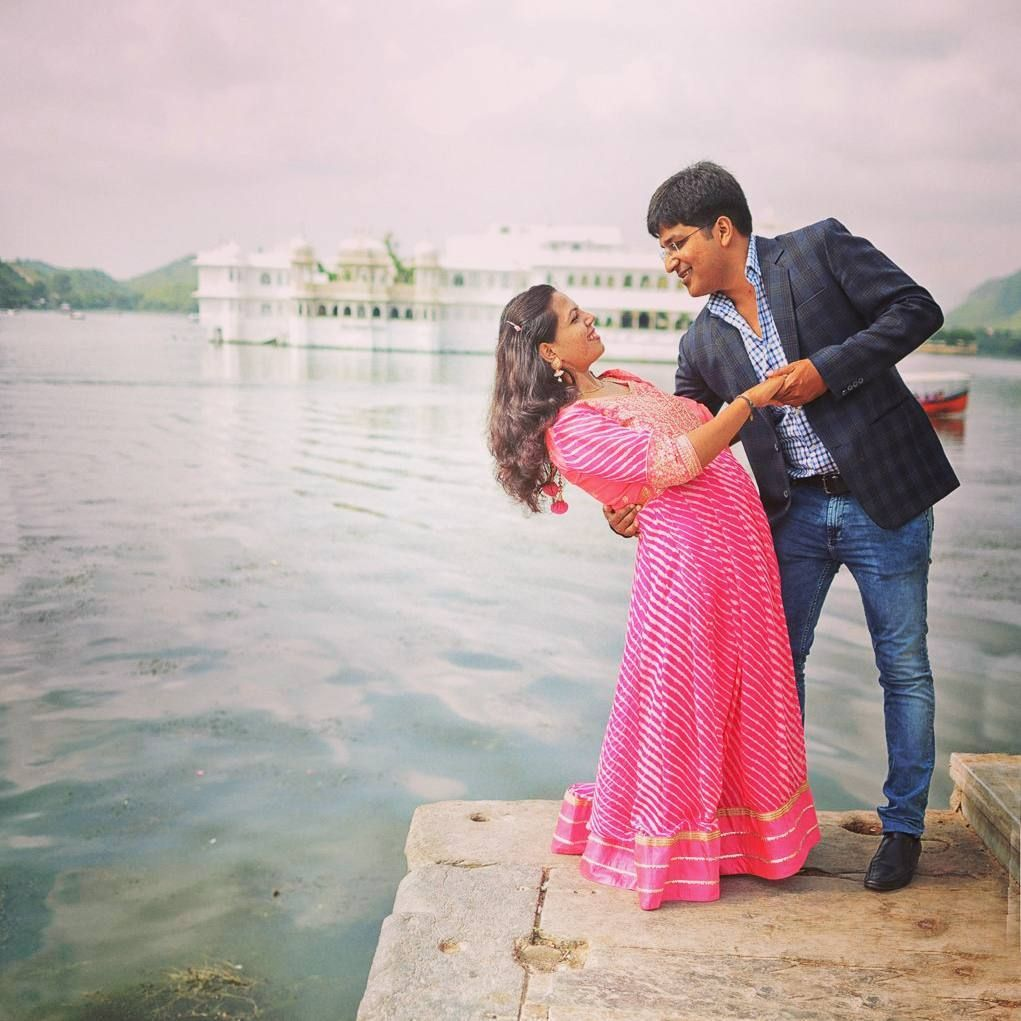 Posing In Front Of The Majestic Hotel Taj Lake Palace Udaipur Contact 919001234111 For Creativ Indian Wedding Photographer Wedding Photoshoot Wedding Film