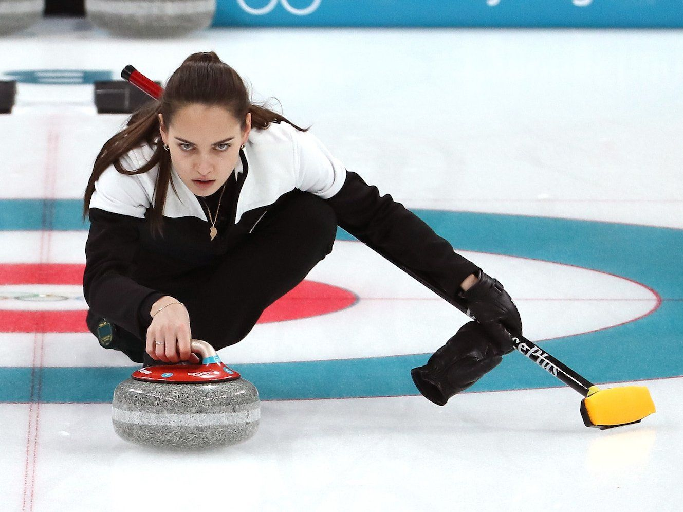 Russian curling athlete falls on ice at Winter Olympics