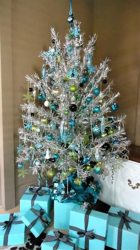 Silver tinsel tree with turquoise yellow and black ornaments - blue and silver christmas decorationschristmas tree decorations