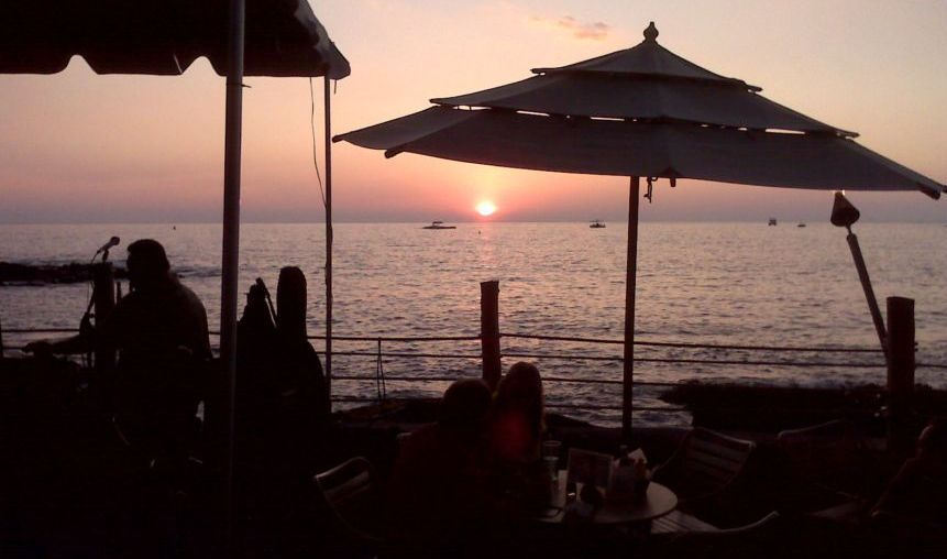 Memories of the Big Island. For years we went to Huggo's on the Rocks in Kailua Kona on Thursday evenings. Sitting at a table in the sand and listening to a small group, and at times a wahine or two doing the hula.