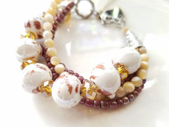 Check out this item in my Etsy shop https://www.etsy.com/listing/268084241/boho-bracelet-strand-bracelet-bead
