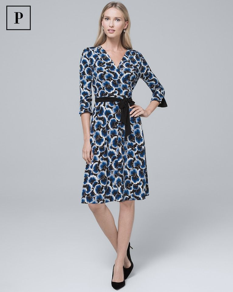 326672eee20e Women s Petite Reversible Floral Print Solid Black Knit Faux-Wrap Dress by White  House Black Market