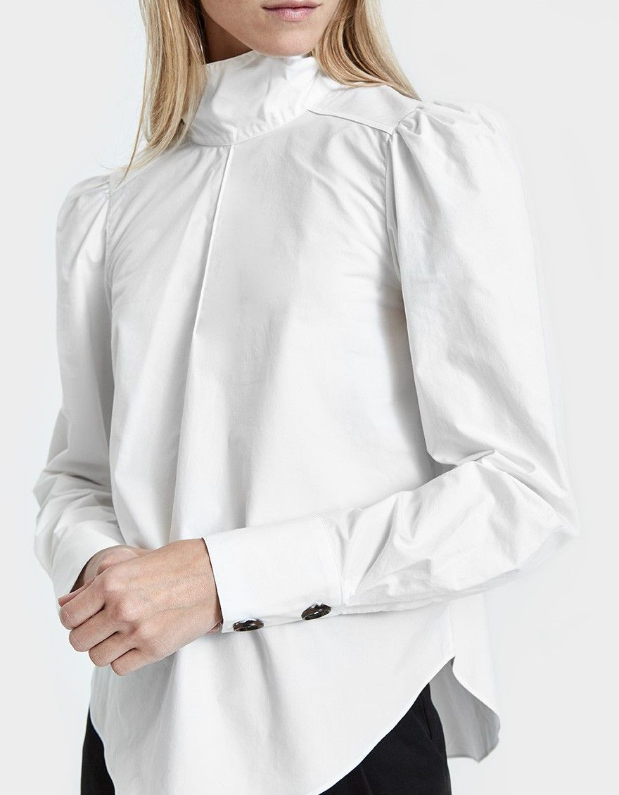 bd1a5da499ec91 Puff sleeve blouse from Fabiana Pigna in White. Cravat neck detail. Long puff  sleeves with double-button cuffs. Shirttail hem.