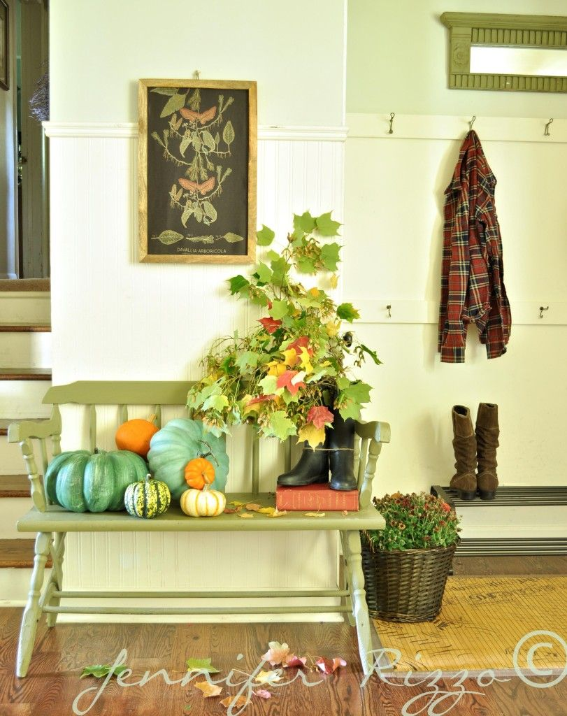 Boots filled with leaves and blue and orange pumpkins add warmth to ...