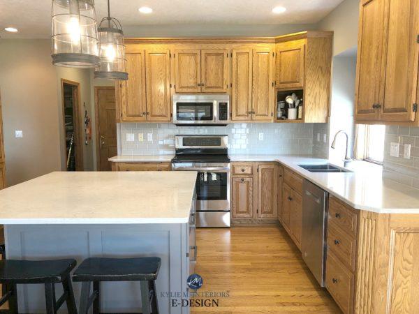 Golden oak kitchen with white quartz countertop